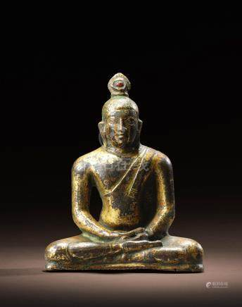 A GILT COPPER ALLOY FIGURE OF BUDDHA   SRI LANKA, LATE ANURADHAPURA PERIOD, 8TH/9TH CENTURY