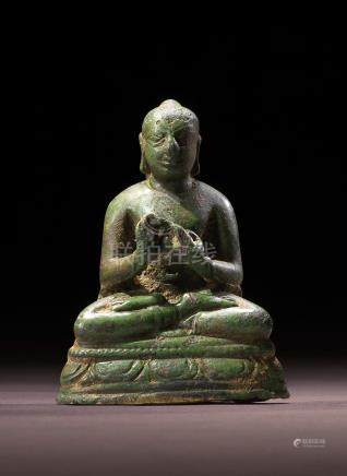 A COPPER ALLOY FIGURE OF BUDDHA NORTHERN INDIA, GUPTA PERIOD, 6TH CENTURY