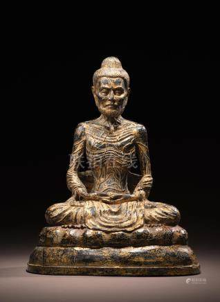 A GILT LACQUERED COPPER ALLOY FIGURE OF EMACIATED BUDDHA  THAILAND, RATTANAKOSIN PERIOD, 19TH CENTURY