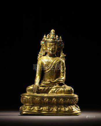 A GILT COPPER ALLOY FIGURE OF CROWNED BUDDHA TIBET, CIRCA 16TH CENTURY