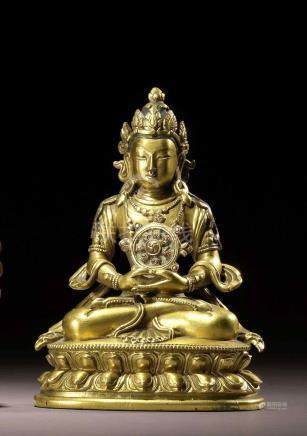 A GILT COPPER ALLOY FIGURE OF AMITAYUS QING DYNASTY, 18TH CENTURY