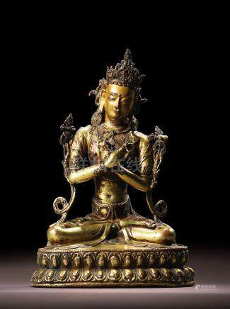 A GILT COPPER ALLOY FIGURE OF VAJRADHARA TIBET, CIRCA 15TH CENTURY