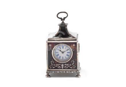 An Edwardian silver and tortoiseshell desk clock by William Comyns, London 1909