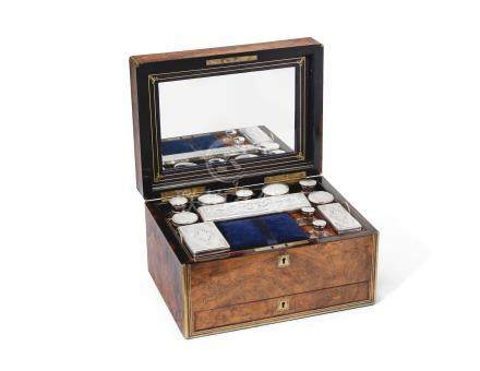A late 19th century silver-plated dressing set in a walnut case unmarked