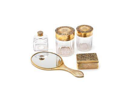 A George IV silver-gilt dressing table set various makers, London 1823 - 1825 (5)