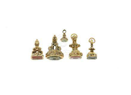 A collection of five yellow metal and hardstone fob seals mid-19th century (5)