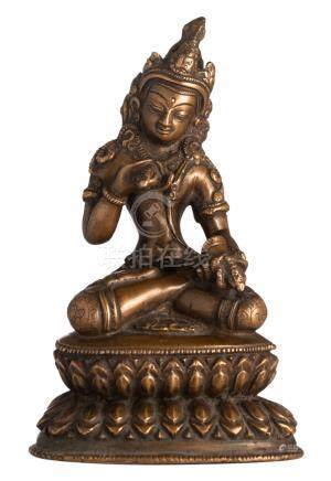 A Sino-Tibetan bronze seated Buddha holding a vajra and a skull cup, with traces of polychromy, H 13,5 cm