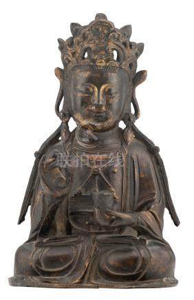 A gilt bronze figure of a Guanyin holding a stem and a cup, Ming, probably 17thC, H 20 cm