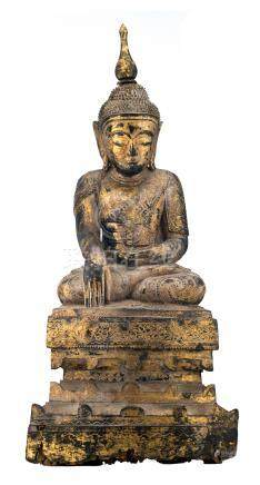 A Burmese gilt lacquered carved wooden seated Buddha on a multi-stepped base, 19thC, H 84,5 cm