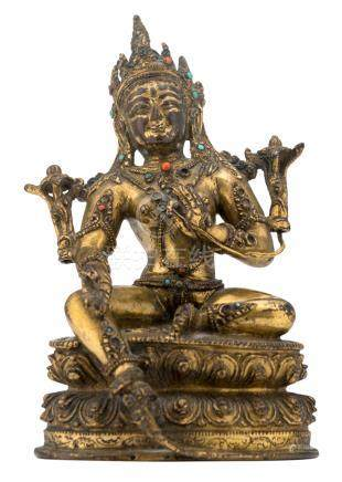 A Sino-Tibetan seated gilt bronze figure of a Green Tara, with semi-precious stone inlay, H 16,5 cm