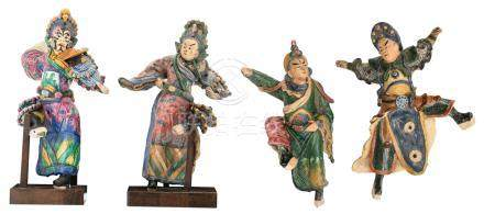 Four Chinese polychrome glazed stoneware figures, two of the figures on a matching wooden stand, H 25 - 33,5 cm