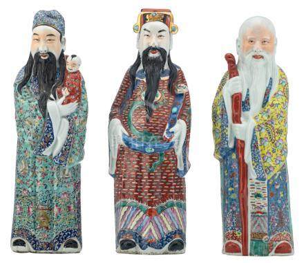 Three Chinese polychrome decorated figures, depicting Fu, Lu and Shou Xing, all figures marked, about 1900, H 45,5 -  46,5 cm