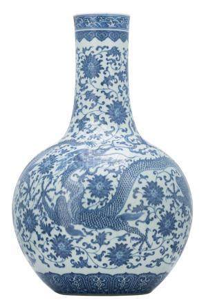 A large Chinese blue and white bottle vase, decorated with a dragon amid scrolling lotus, H 58,5 cm