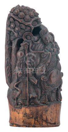 A Chinese bamboo sculpture, depicting the figures of Shou Xing, a Guanyin and some servants, H 40 cm