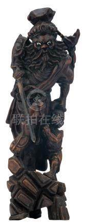 A Chinese carved hardwood group, depicting a warrior-god and a vanquished, H 54,5 cm