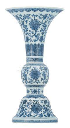 A Chinese two-piece blue and white Gu vase, decorated with scrolling lotus, with key pattern, ruyi heads and petal friezes, marked, H 42,5 cm