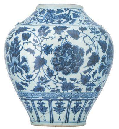 A Chinese blue and white vase, decorated with scrolling lotus and Fu lions, H 45,5 cm