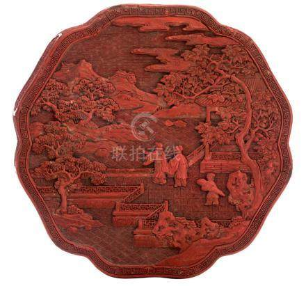A Chinese red cinnabar lacquered scalloped box and cover, the cover decorated with figures on a terrace in a mountainous landscape, 18th / 19thC, probably Qianlong, H 7,5 - ø 18,5 cm