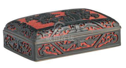 A late 19th / early 20thC Chinese red an black lacquered box and cover, H 5 - W 5 - D 10 cm