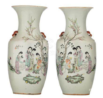 A pair of Chinese famille rose vases, decorated with a gallant garden scene and calligraphic texts, marked, H 43 - 43,5 cm