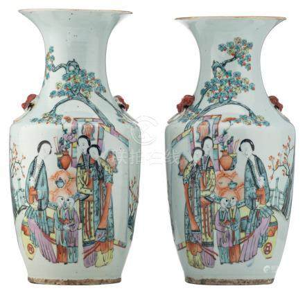A pair of Chinese polychrome vases, decorated with ladies and children in a garden, and calligraphic texts, H 42,5 - 43 cm