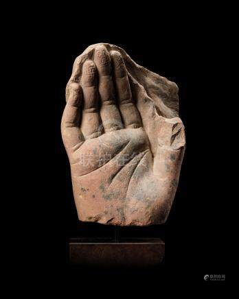 A RED SIKRI SANDSTONE HAND OF BUDDHA NORTHERN INDIA, KUSHAN PERIOD, 2ND CENTURY