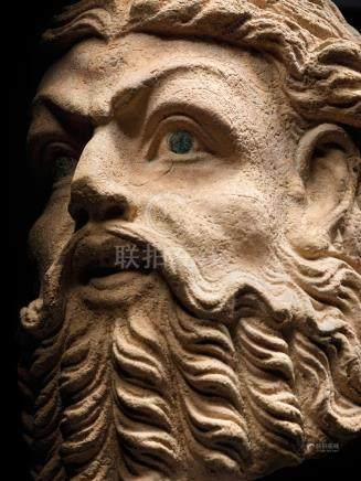 A BRONZE INLAID MARBLE HEAD OF A BEARDED MAN  ANCIENT REGION OF GANDHARA, CIRCA 3RD CENTURY