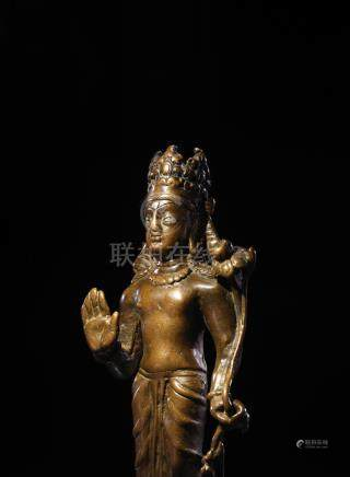 A SILVER INLAID COPPER ALLOY FIGURE OF A BODHISATTVA SWAT VALLEY, CIRCA 600