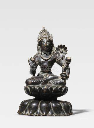 A SILVER INLAID COPPER ALLOY FIGURE OF PADMAPANI LOKESHVARA SWAT VALLEY, 7TH CENTURY
