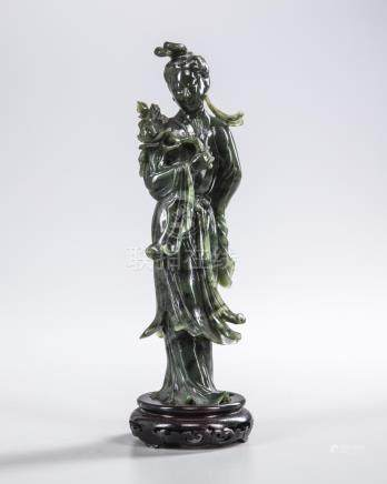 A CHINESE SPINACH-GREEN JADE CARVING OF A MAIDEN