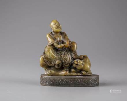 A CHINESE SOAPSTONE FIGURE WITH A STAND