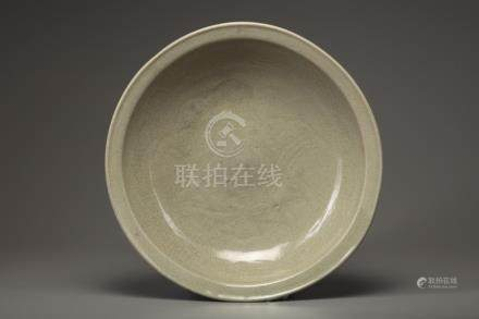 A LARGE CARVED CELADON DISH