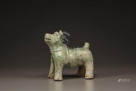 A GREEN GLAZED POTTERY FIGURE OF A DOG