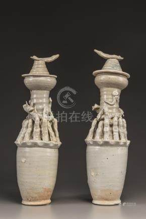 TWO QINGBAI FUNERARY JARS WITH COVERS