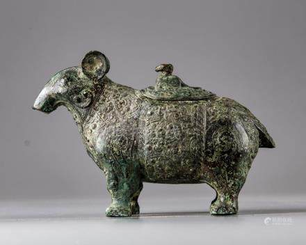 A BRONZE TAPIR FORM LIDDED VESSEL