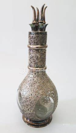 A Hong Kong Silver Mounted Decanter divided into four compartments, the overlay with pierced