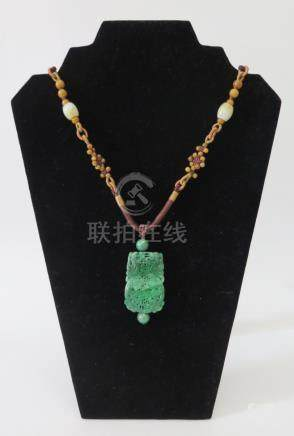 A Chinese Carved and Pierced Jadeite Pendant, c. 46mm