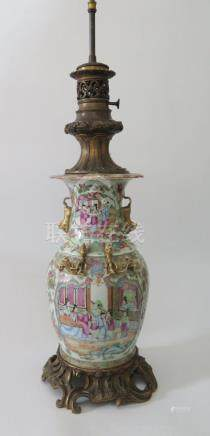A Nineteenth Century Cantonese Porcelain Famille Rose Vase with rococo ormolu mounts, drilled to