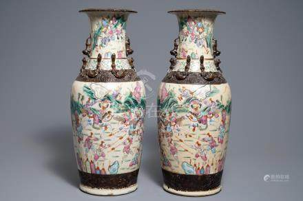 A pair of Chinese Nanking famille rose crackle-glazed vases with warriors design, 19th C.