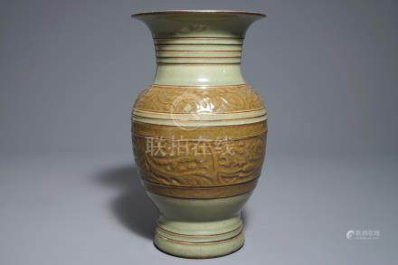 A Chinese archaistic celadon-glazed vase with moulded design, 19th C.