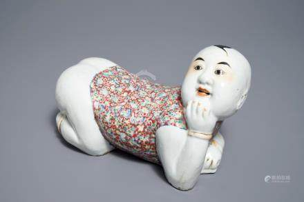 A Chinese famille rose headrest in the shape of a boy, Republic, early 20th C.