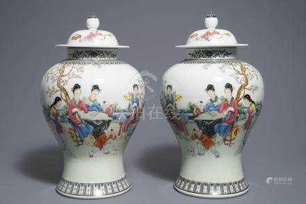 A pair of Chinese famille vases and covers, Qianlong mark, 20th C.