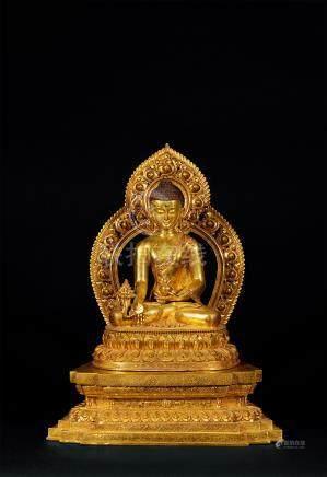 铜鎏金药师佛坐像
