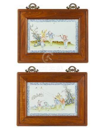 A pair of painted porcelain plaques