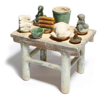 A Chinese pottery altar in Han Dynasty style, together with part glazed pottery offerings,