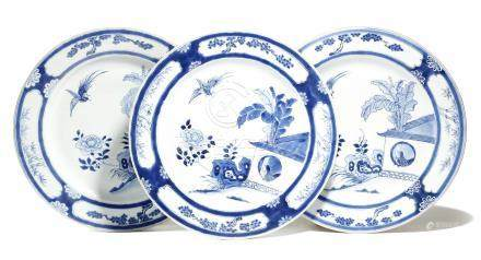 A set of three Chinese porcelain blue and white shallow dishes, painted with a bird in the house