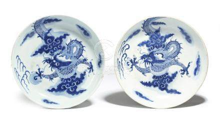 A matched pair of Chinese porcelain blue and white saucer dishes, each decorated with scaly