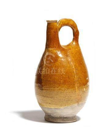 A Chinese ochre glazed pottery pilgrim flask, Liao Dynasty, 23.5cm high.Provenance: Christie's South