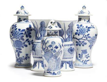 A small pair of Chinese porcelain blue and white yen-yen vases, together with a pair of blue and