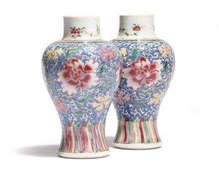 A small pair of Chinese porcelain famille rose baluster vases, decorated with flowers on a scrolling